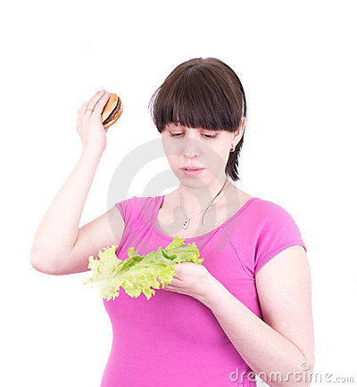 The young woman throws out a hamburger