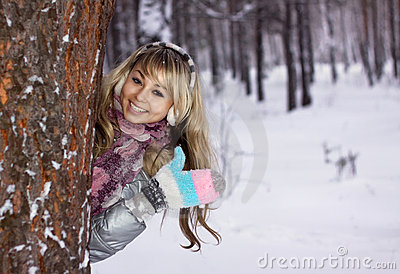 Young woman thumbs-up in winter forest