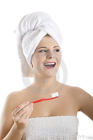 Young woman with tooth brush in a towel