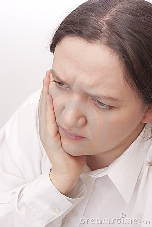 Young woman with a toothache
