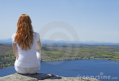 Young woman on top of a mountain