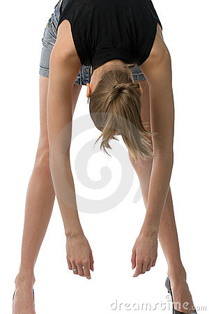 Young woman touching toes