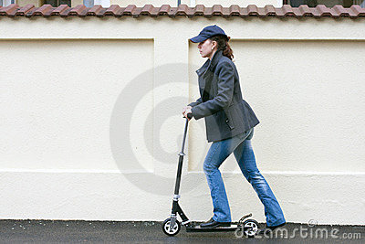Young woman with toy scooter