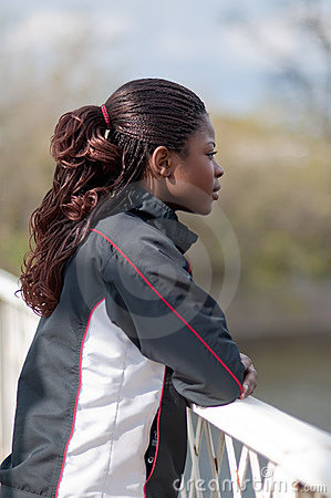 Young woman in track suit in profile