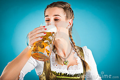 Young woman in traditional clothes and beer