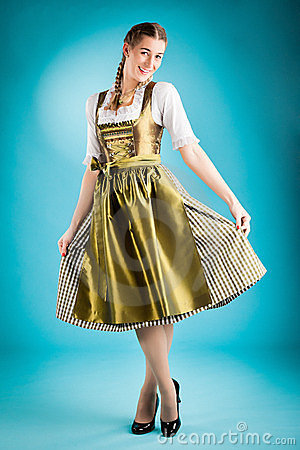 Young woman in traditional clothes - dirndl