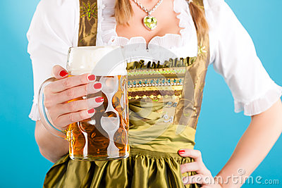 Young woman in traditional clothes  or dirndl