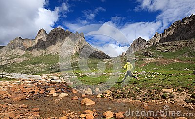 Runner running at high altitude mountains Stock Photo