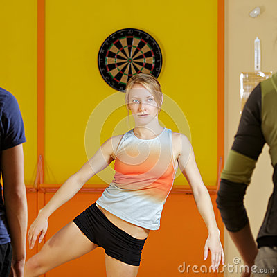 Young woman training aerobics group