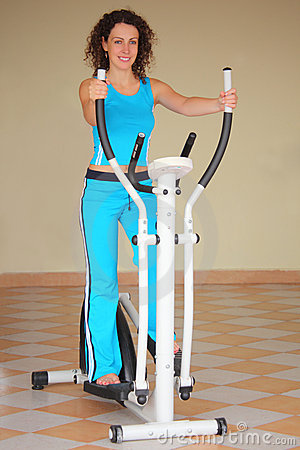 Young woman on training apparatus
