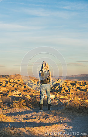 Free Young Woman Traveller Standing And Watching Sunrise, Cappadocia, Central Turkey Royalty Free Stock Images - 83214639