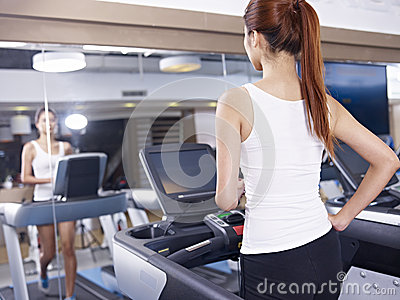 Young woman on treadmill