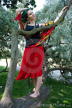 Young woman on the tree