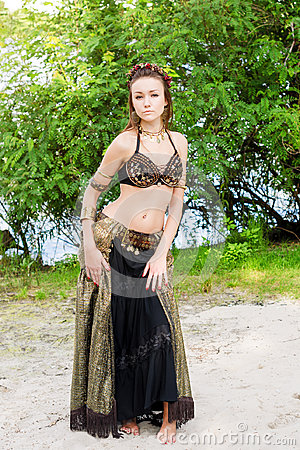 Free Young Woman Tribal American Style Dancer. Girl Dancing And Posing On The Beach Sand Wearing Belly Dance Costume. Ethnic Stock Image - 97098711