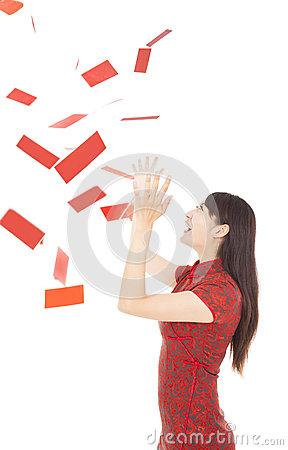 Young woman trying to catch red envelope