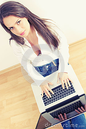 Young woman typing on laptop computer
