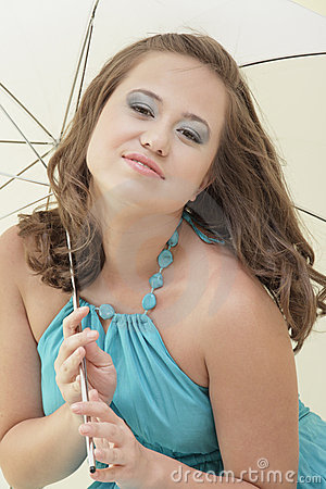 Young woman and an umbrella