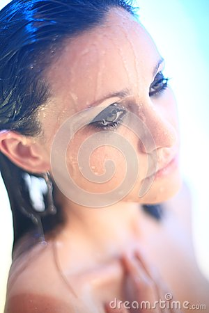 Young woman under shower spray