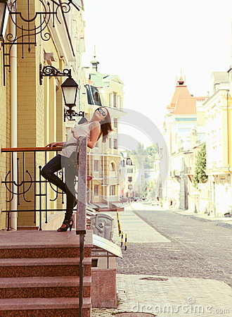 Young Woman Upstairs Posing Outdoors