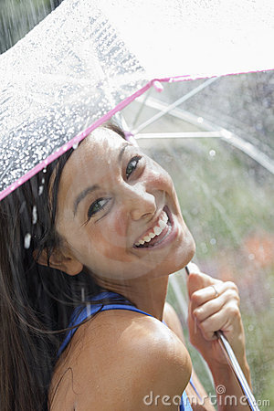 Free Young Woman Using An Umbrella In Rain Stock Photography - 15673592