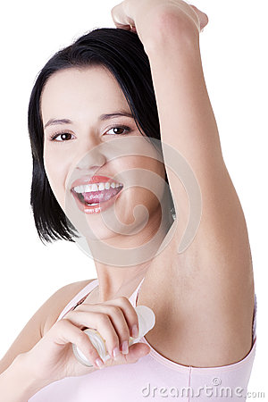 Young woman using antiperspirant