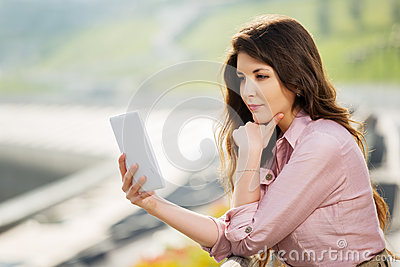 Young fashion woman using a digital tablet computer