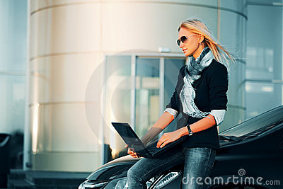 Young business woman using laptop outdoor