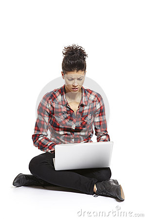 Young woman using laptop confused