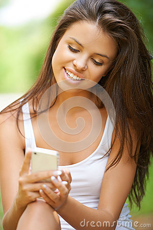 Young woman using mobile phone