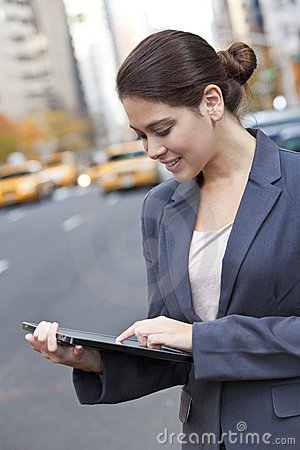 Young Woman Using Tablet Computer in New York City