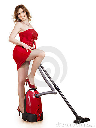 Young woman using vacuum cleaner.