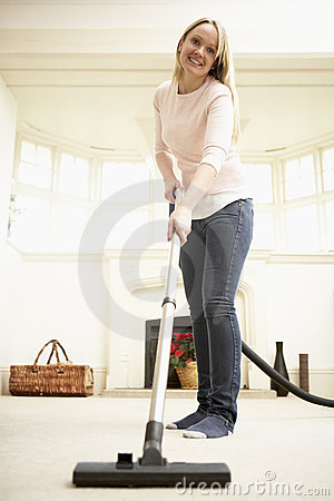 Young Woman Using Vacuum Cleaner