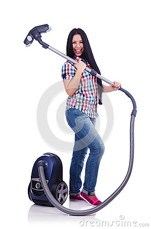 Young woman with vacuum cleaner