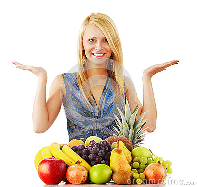 Young woman with variety of fruits