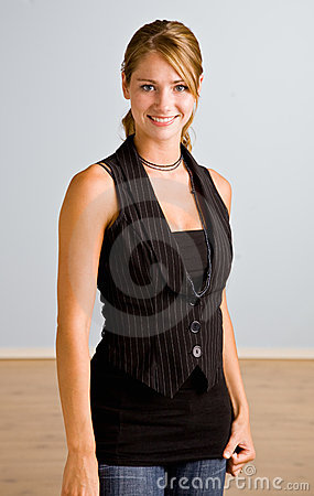 Young woman in vest smiling