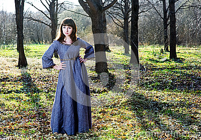Young woman in vintage dress in the forest