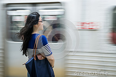 Young woman waiting at subway station