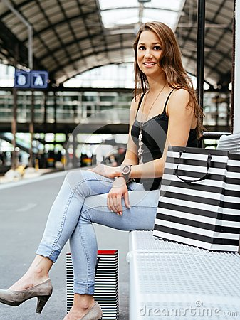 Young woman waiting at the train station