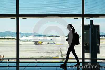 Young woman walking at airport