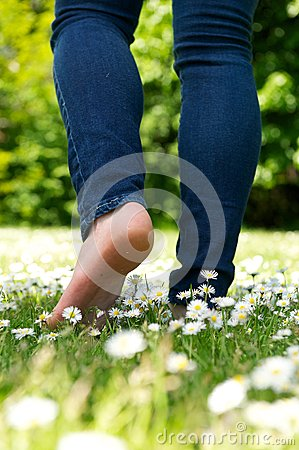 Free Young Woman Walking Barefoot On Green Grass In The Park Stock Photo - 31881860