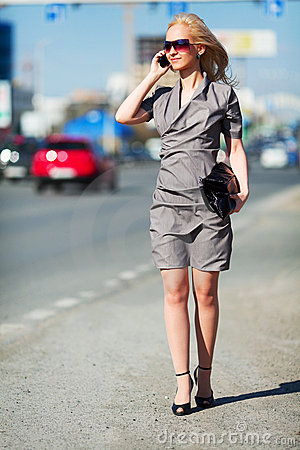 Young woman walking on a city street.