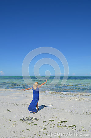 Young woman walking on an exotic beach.
