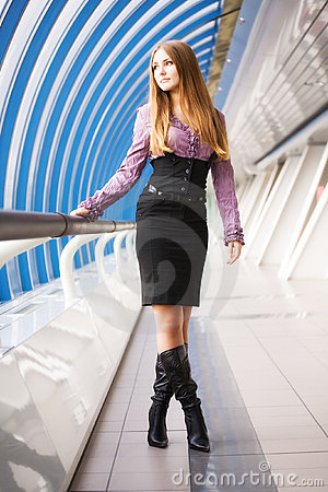 Young woman walking on modern bridge