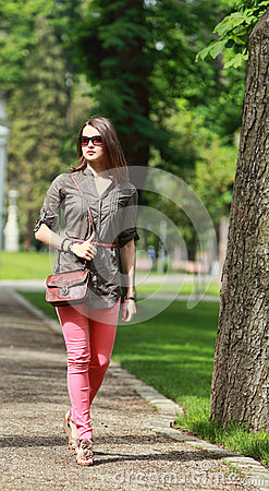 Young Woman Walking in a Park