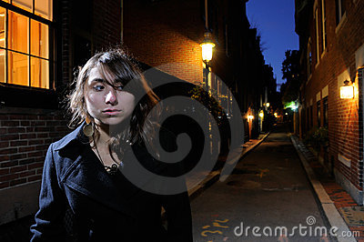 Young Woman Walking the Streets at Night