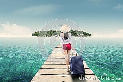 Young woman walking toward island
