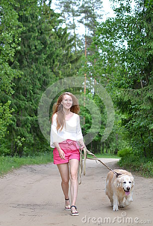 Free Young Woman Walking With Golden Retriever Royalty Free Stock Image - 94634926