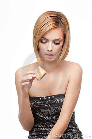 Free Young Woman Wanting To Taste A Wafer Stock Photos - 16717873