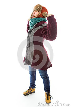 Young woman in warm clothing and celebrating success