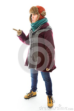 Young woman in warm clothing and showing something